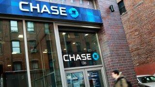 A man enters a JP Morgan Chase branch bank