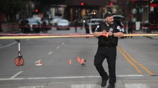 Police investigate where a shooting took place on Michigan Ave. hours after the city suffered from widespread looting and vandalism
