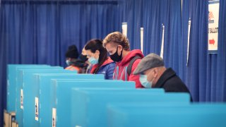 In this Oct. 2, 2020, file photo, residents vote at an early voting site in Chicago, Illinois.