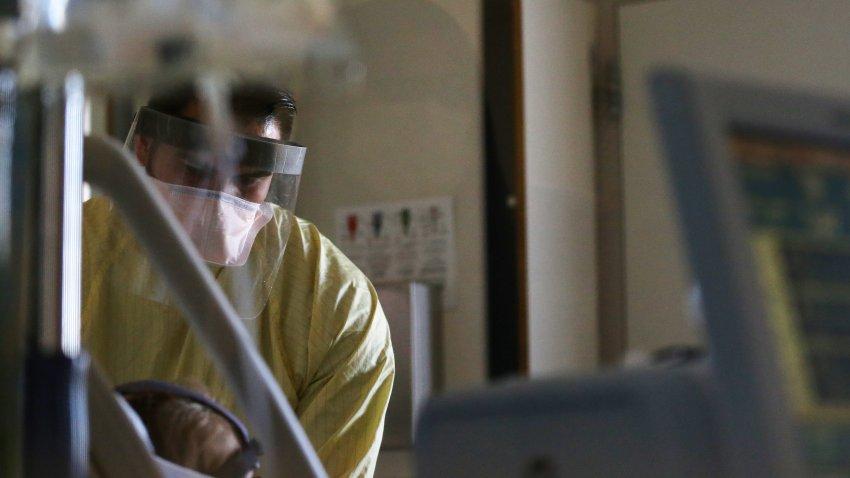 Registered nurse Eduardo Eran cares for a COVID-19 patient.