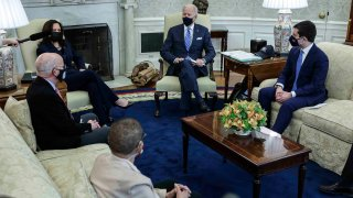 In this March 4, 2021, file photo, President Joe Biden, Vice President Kamala Harris, and Transportation Secretary Pete Buttigieg meet with a bipartisan group of House members on infrastructure in the Oval Office of the White House in Washington, D.C. Participants include Rep. Peter DeFazio (D-OR) (left) and Rep. Eleanor Holmes Norton (D-DC) (center).