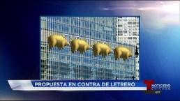 Cerdos voladores para ocultar letrero de Trump