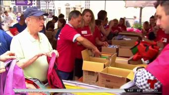 Donan mochilas con útiles escolares a miles de niños